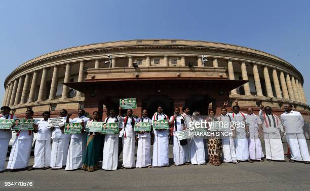 All India Anna Dravida Munnetra Kazhagam political party MPs shout slogans during a protest over the Kaveri river dispute outside Parliament in New...