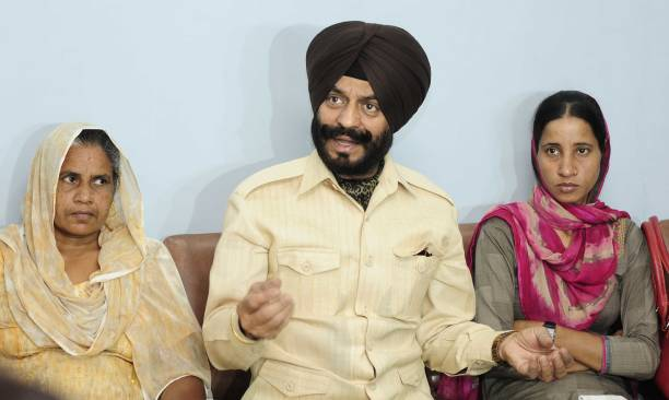 All India AntiTerrorist Front Chairman MS Bitta along with the family members of Martyr Sepoy Mandeep Singh of Indian Army during a press conference..
