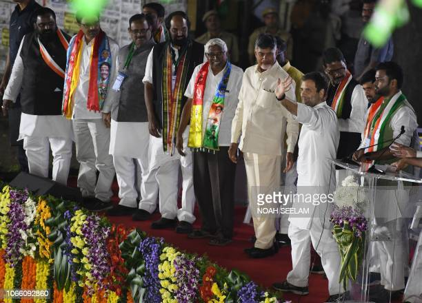 All India Congress Committee President Rahul Gandhi waves to people as Chief Minister of Andhra Pradesh and Telugu Desam Party president N...