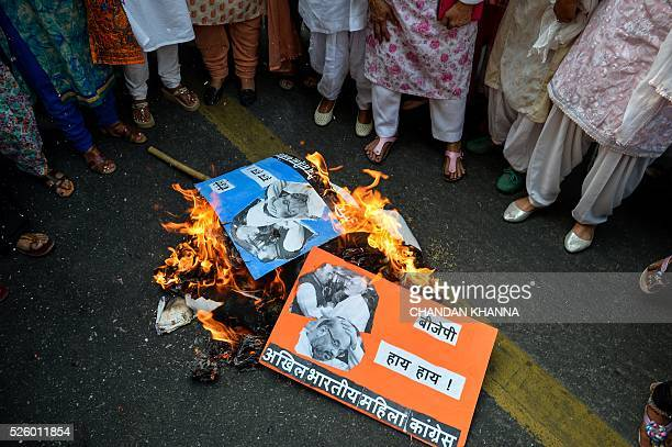 All India Mahila Congress supporters burn effigies of Indian Prime Minister Narendra Modi and ruly Bhartiya Janta Party President Amit Shah as they...