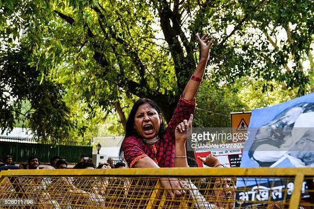 TOPSHOT All India Mahila Congress supporters shout slogans as they protest against the ruling Bhartiya Janta Party government accusing them of...