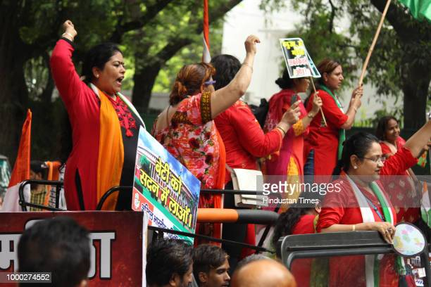 All India Mahila Congress workers raise slogans as they take out a jeep rally to protest against the centre over the passage of Women's Reservation...