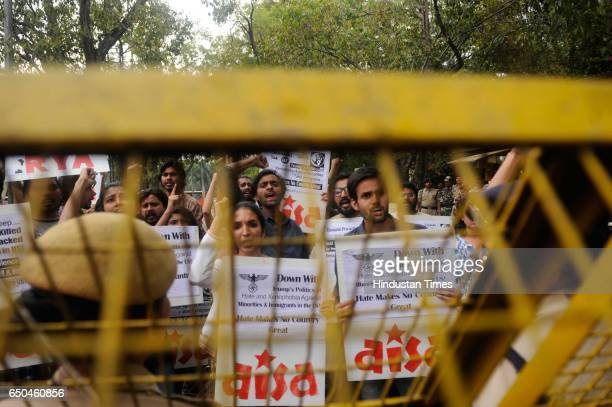 All India Students' Association members shout slogans during a protest as they try to march towards the US Embassy, on March 9, 2017 in New Delhi,...