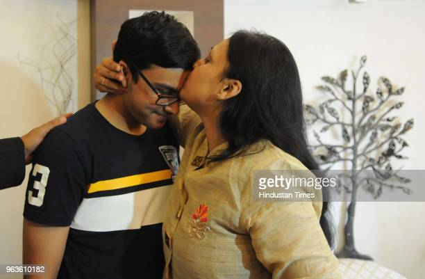 All India topper Prakhar Mittal's mother kisses on his forehead after Central Board of Secondary Education declared class 10th results on May 29 2018...
