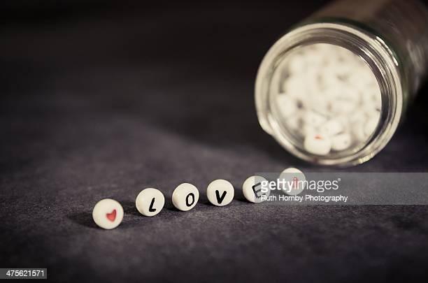all is love - perlenschnur stock-fotos und bilder