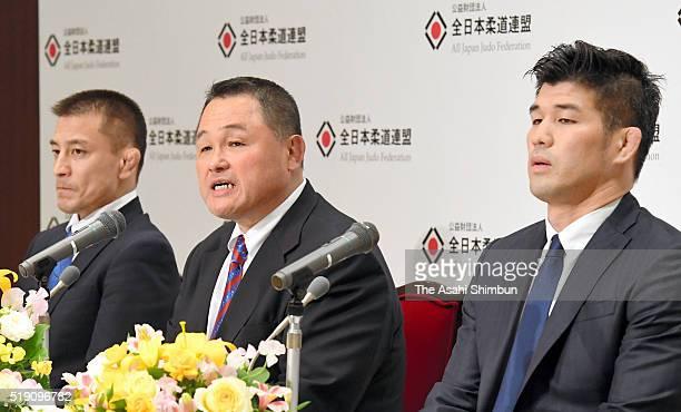 All Japan Judo Federation vice president Yasuhiro Yamashita speaks while Japan Men's team head coach Kosei Inoue and Women's team head coach...
