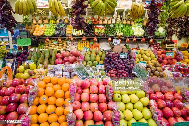 All kinds of fruits like apple, orange, banana, pear, kiwi, grapes, pomme de granate are displayed for sale in the local market.