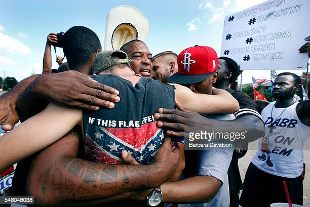 All Lives Matter protesters come together for a group hug with join Black Lives Matter activists in Dallas at Park Ln Fair Oaks Ave July 10th All...