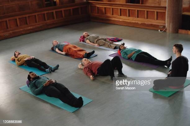 All male Yoga class - Savasana