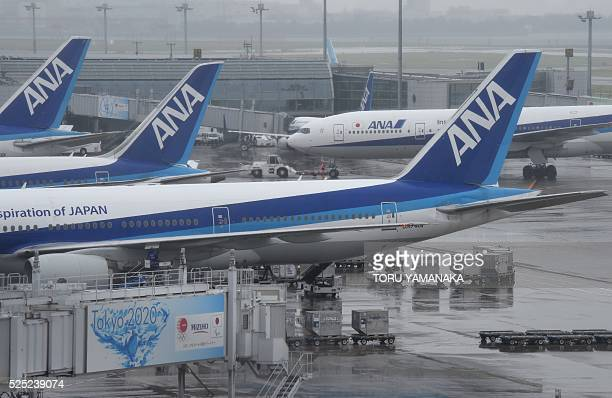 All Nippon Airways aircraft are seen parked at Haneda Airport in Tokyo on April 28 2016 The Japanese airline will announce its financial results for...