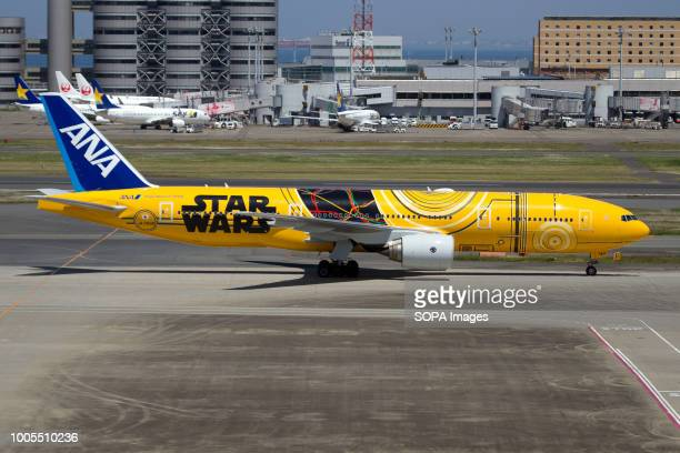 All Nippon Airways Boeing 777200ER celebrating Star Wars saga with a scheme dedicated to C3PO character taxiing at Tokyo Haneda
