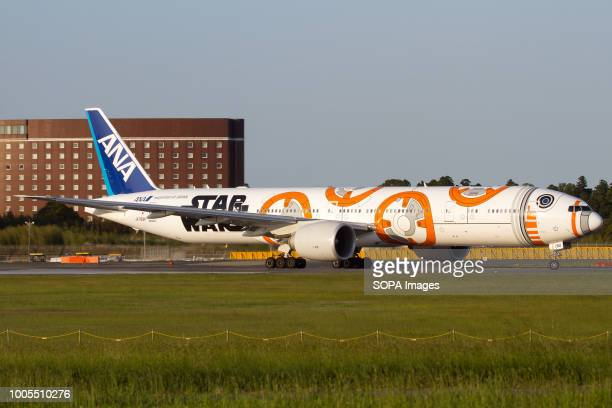 All Nippon Airways Boeing 777300ER celebrating Star Wars saga with a scheme dedicated to BB8 character taxiing at Tokyo Narita
