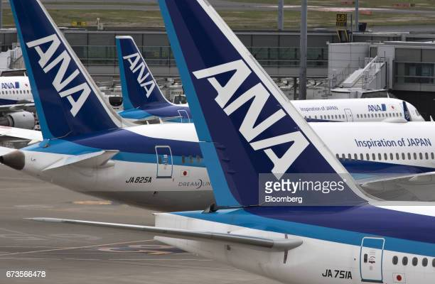All Nippon Airways Co aircraft stand parked at Haneda Airport in Tokyo Japan on Wednesday April 26 2017 ANA is scheduled to release Fourthquarter...