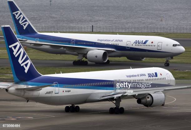 All Nippon Airways Co aircraft taxi at Haneda Airport in Tokyo Japan on Wednesday April 26 2017 ANA is scheduled to release Fourthquarter earnings...
