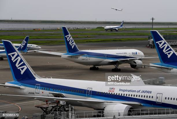 All Nippon Airways jetliners are seen on the tarmac and taxiway at Haneda international airport in Tokyo on August 2 2017 Japan's All Nippon Airways...