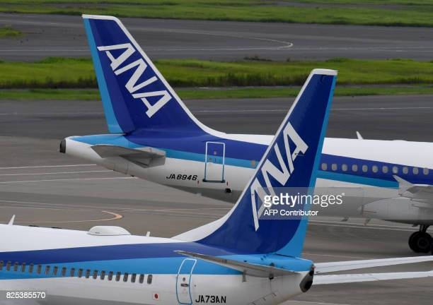 All Nippon Airways jetliners are seen on the tarmac at Haneda international airport in Tokyo on August 2 2017 Japan's All Nippon Airways is expected...