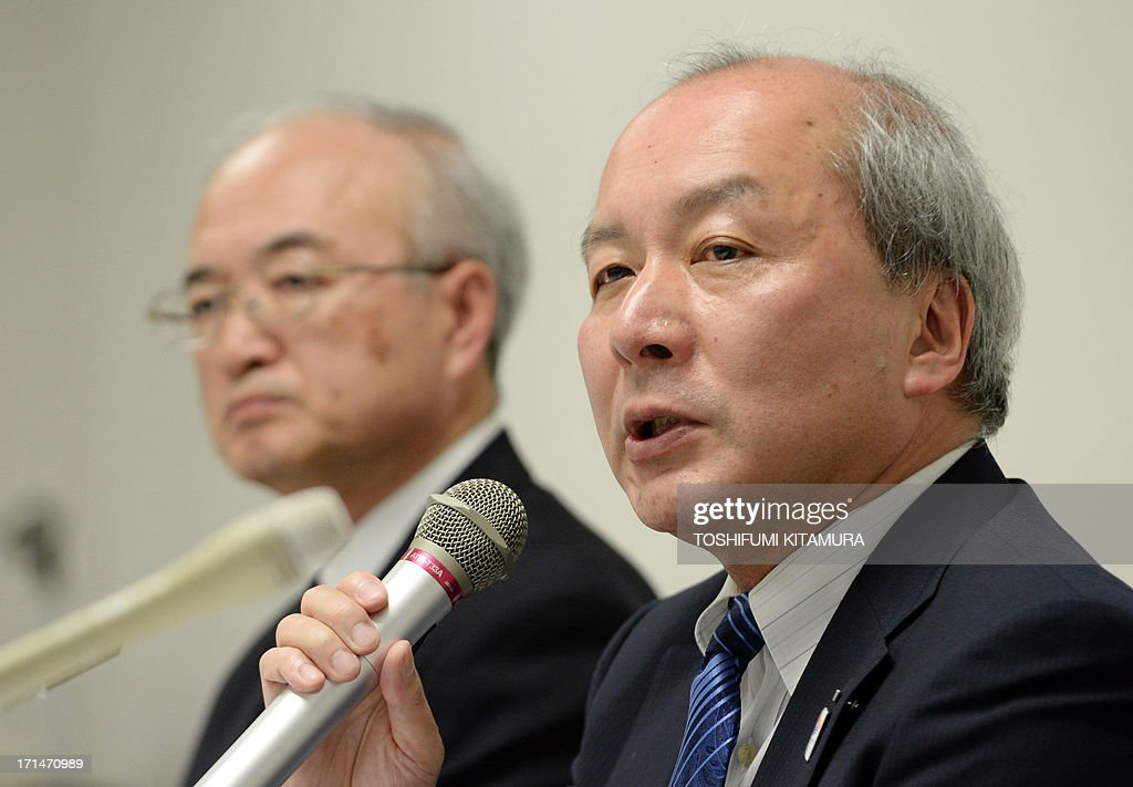 All Nippon Airways (ANA) senior vice president Shinzo Shimizu (R) answers a question next to the company's executive vice president Yoshinori Maruyama (L) during a press conference at the company's headquarters in Tokyo on June 25, 2013. ANA announced the dissolution of tie-up with Malaysia-based AirAsia on their business in Japan.
