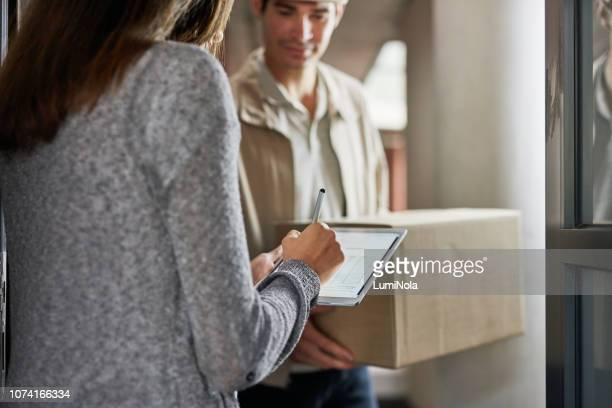 all our deliveries are handled with efficiency in mind - autographs stock photos and pictures