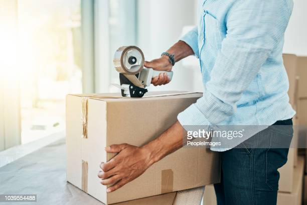 all packed and ready to move on - tape dispenser stock photos and pictures
