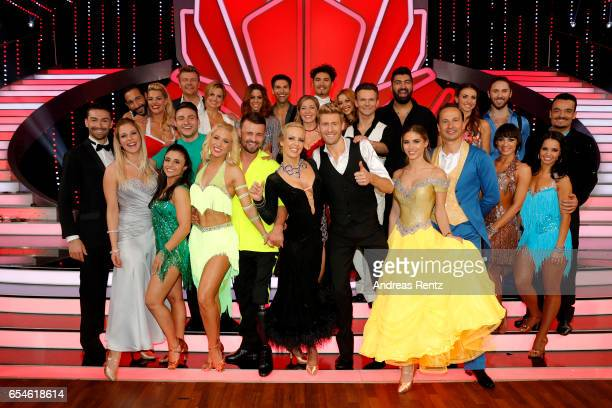 All participants pose for a group photo after the 1st show of the tenth season of the television competition 'Let's Dance' on March 17, 2017 in...