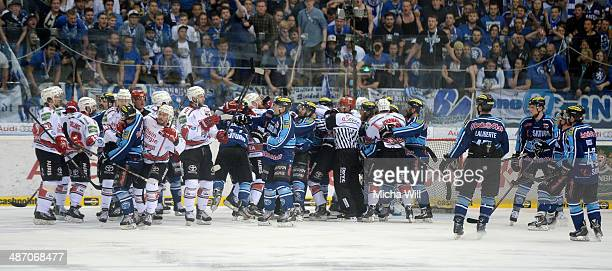 All players of both teams start a fistfight after Koeln scored the first goal in game six of the DEL final playoffs between ERC Ingolstadt and...