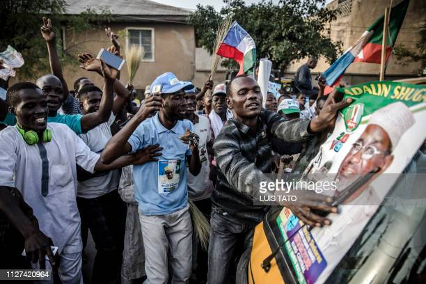 All Progressives Congress Party supporters celebrate after initial results were released by the Nigerian Independent National Electoral Commission in...