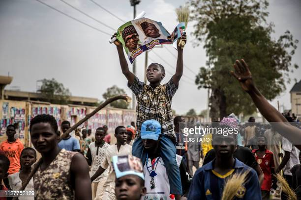 TOPSHOT All Progressives Congress party supporters rally as they celebrate the reelection of the incumbent president and the leader of APC in Kano on...