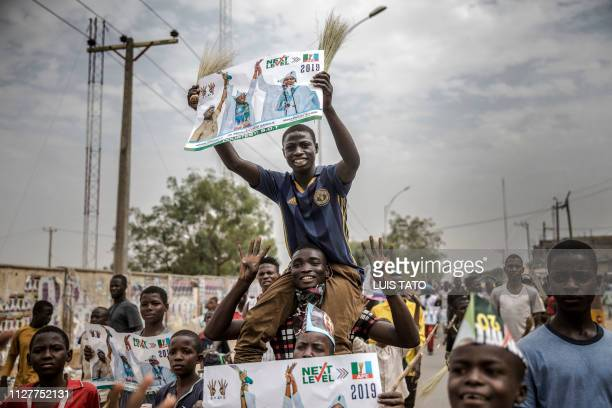 All Progressives Congress party supporters rally as they celebrate the reelection of the incumbent president and the leader of APC in Kano on...