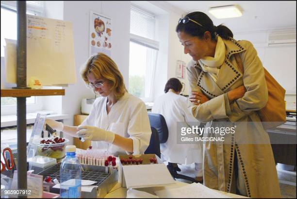 All publications must be approved Mrs Cristina Owen Jones UNESCO Goodwill Ambassador for HIV/AIDS prevention education visits the serology laboratory...