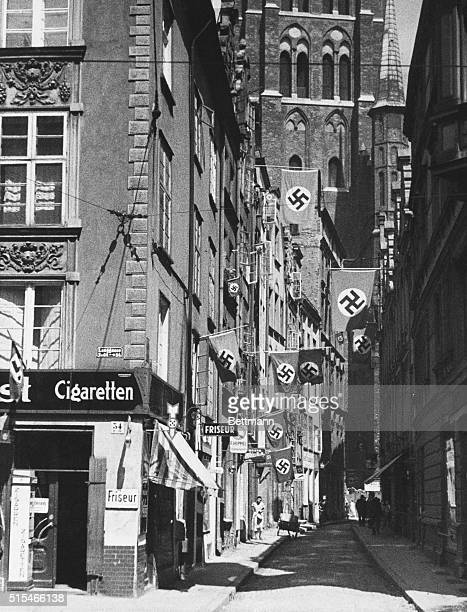 All Quiet in Danzig Danzig Poland A picture just received showing a swastikabedecked street in Danzig The Free City seems very tranquil in this study...