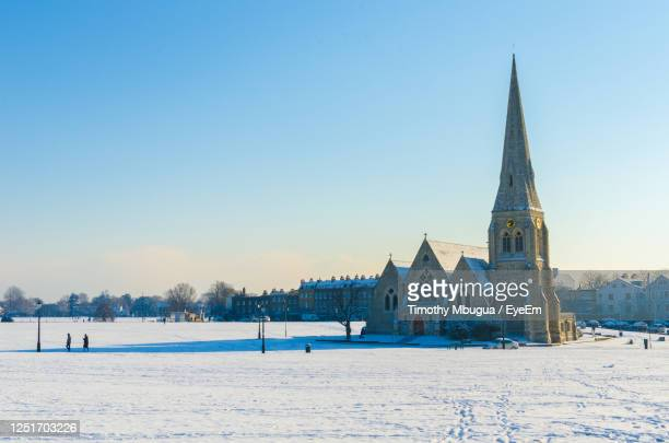all saints anglican church at blackheath village on a snowy day, greenwich and lewisham, london. - village stock pictures, royalty-free photos & images