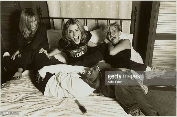 All Saints posed on a bed in a London photographic studio in 1997 LR Melanie Blatt Nicole Appleton Shaznay Lewis Natalie Appleton