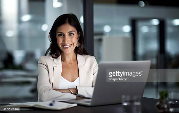 all set for a productive night ahead - businesswoman stock pictures, royalty-free photos & images