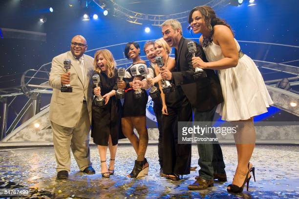 All seven past American Idol winners Ruben Studdard Kelly Clarkson Fantasia Barrino David Cook Carrie Underwood Taylor Hicks and Jordin Sparks hold...