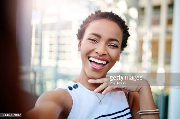 all she needs is her smile to glow up her selfies - selfie stock pictures, royalty-free photos & images