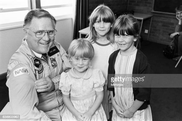 All smiles as these three Huddersfield youngsters come facetoface with a real spaceman Dr Don Lind a NASA astronaut for 20 years was in Huddersfield...