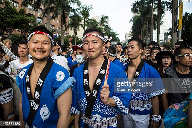 All smiles from gay men wearign traditional Japanese clothing at Taipei Pride. The annual march through Taipei's city streets is the largest in Asia,...