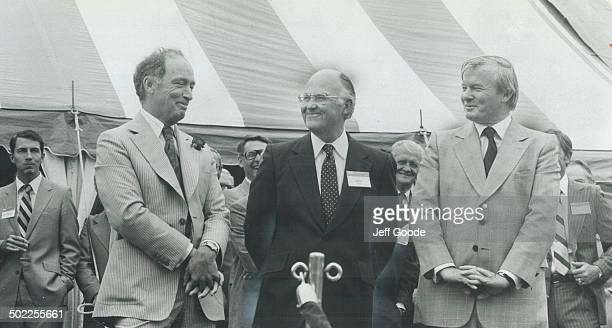 All smiles Looking pleased with themselves Prime Minister Pierre Trudeau Stelco president John Allen and Premier William Davis wait for opening...