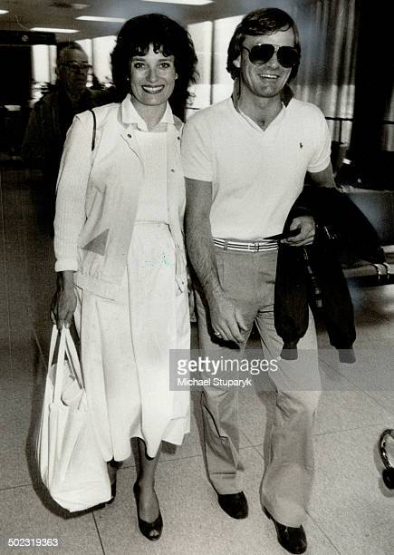 All smiles Margaret Trudeau and her new husband Fried Kemper walk through Pearson International Airport today after their marriage yesterday The...
