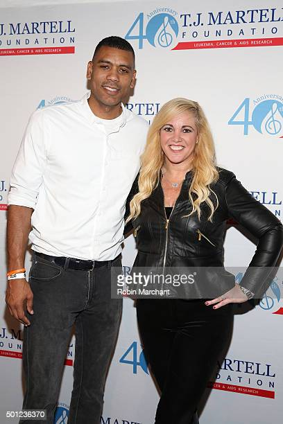 All Star Allan Houston and Honoree Alissa Pollack attend TJ Martell Foundation's 16th Annual New York Family Day at Wythe Hotel on December 13 2015...