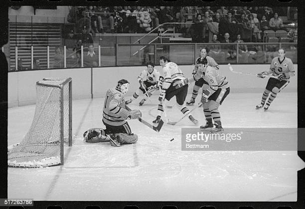 NHL All Star Game New York West Division's goalie Tony Esposito watches puck as teammate Barry Gibbs heads at him during NHL EastWest Division...