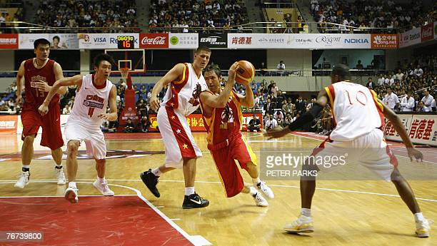 NBA All Star guard Steve Nash goes for a fastbreak as NBA player Paul Davis Houston Rocket star Yao Ming and Sun Yue guard during a play in a...