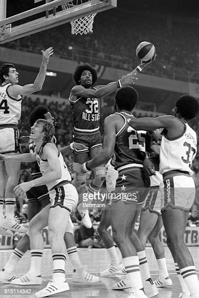 ABA All Star Julius Erving takes a first period jump shot for two points during the 1st period of the ABA All Star game here 1/27 Also pictured are...