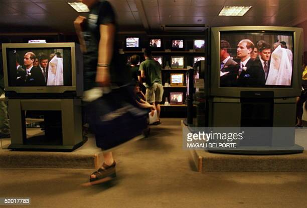 All television screens in the TV department of a central London store are tuned into the wedding at Windsor Castle of Britain's Prince Edward...