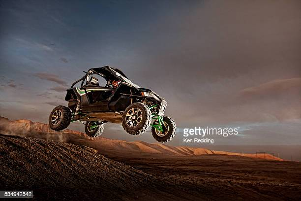 all terrain vehicle in mid-air - jeep stock pictures, royalty-free photos & images