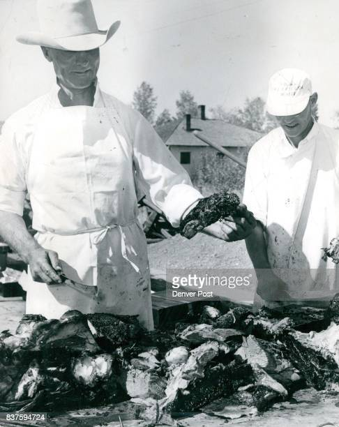 All the cooking at a barbecue is carried out on a large scale as witness at right George F Love using a shovel to stir a huge pot of beef stew at the...