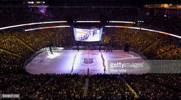 All the members of the San Jose Sharks and Vegas Golden Knights line up as the American national anthem is performed before their game at TMobile...