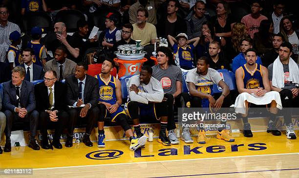 All the starters of Golden State Warriors follow the action from the bench after they were taken out by head coach Steve Kerr in the closing minutes...