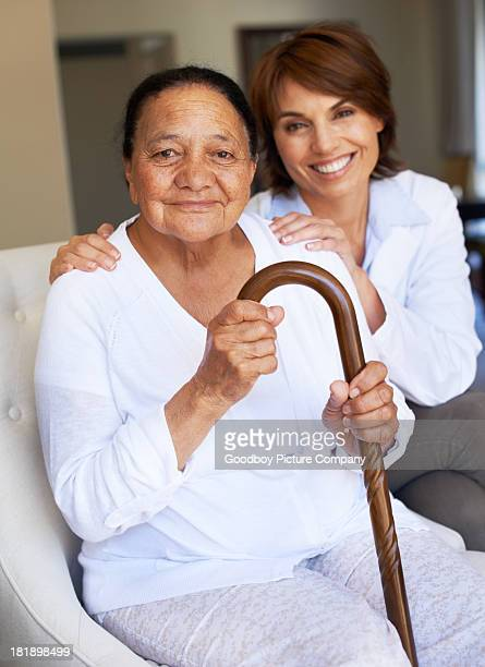 all the support she needs - walking cane stock photos and pictures