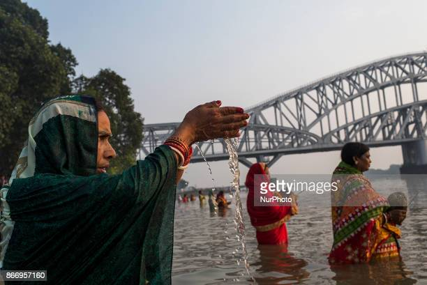 All the women are praying to the Sun God in the waist deep water during the Chhath puja celebrations in Kolkata West Bengal on October 26 2017
